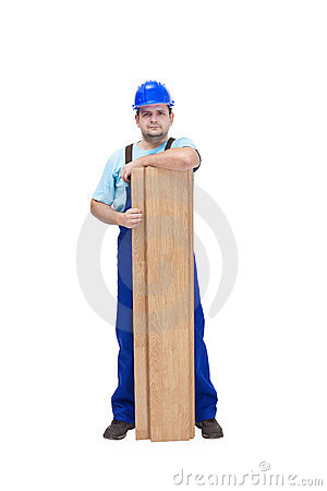 Worker with flooring planks