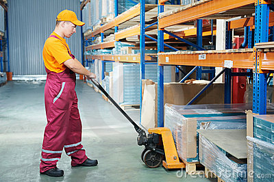 Worker With Fork Pallet Truck Royalty Free Stock Image - Image: 20107086