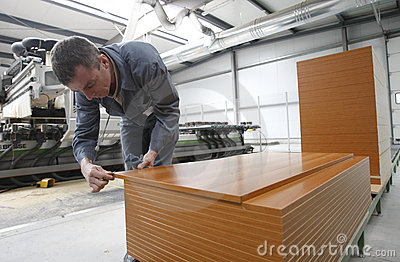 Worker in furniture factory Editorial Stock Image