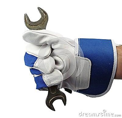 Hand holding spanner
