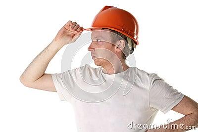 Worker in helmet looks into the distance