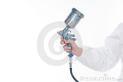 Worker holding airbrush gun