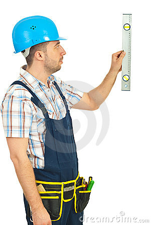 Worker holding construction bubble level