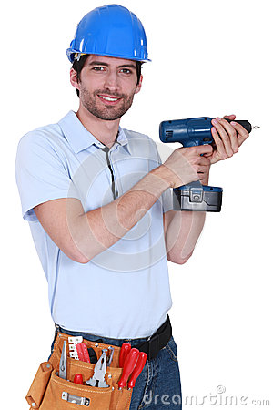 Worker holding a drill.