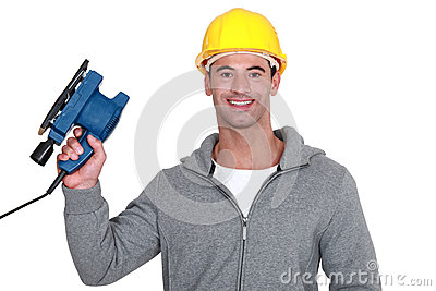 Worker holding power sander