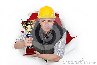Worker holding a trophy cup.