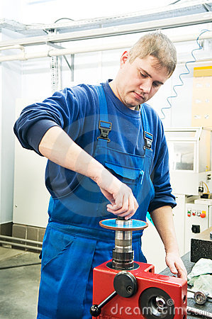 Worker installing cutting tool