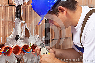Worker installing electrical wires