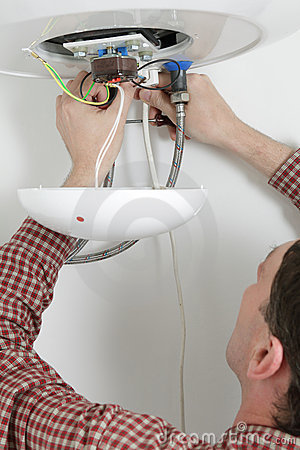 Worker installing a water heater