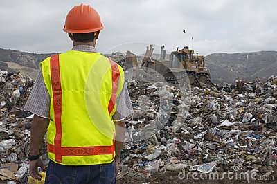 Worker At Landfill Site
