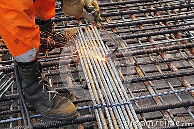 Worker legs weld metal grating Stock Photo
