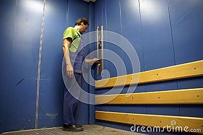 Worker in lift 3