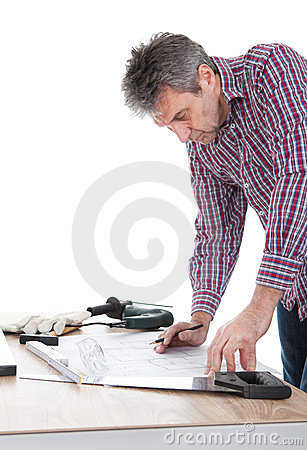 Worker looking into a house plan