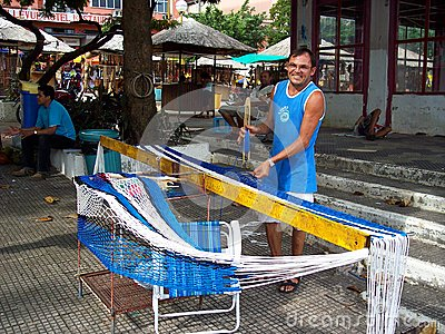 Man working building a hammock Editorial Image