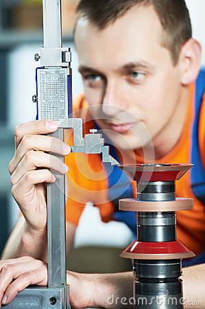 Free Worker Measuring Cutting Tool Royalty Free Stock Photo - 25266265