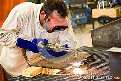 Worker in Metal Factory