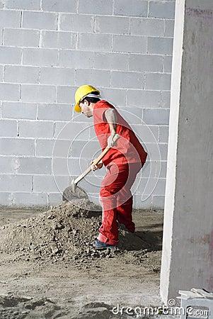 Worker Mixes Dirt - Vertical