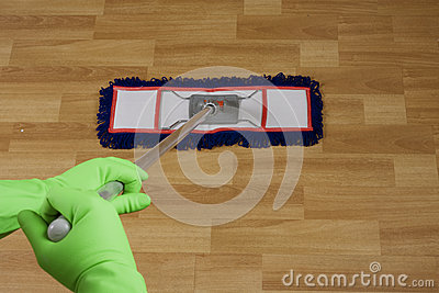 A worker is Mopping  floor