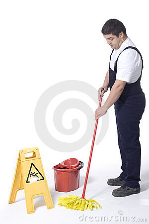 A worker is Mopping white floor