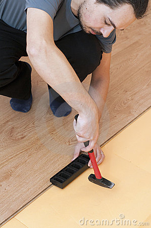 Worker mounting laminated floor