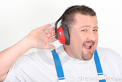 Worker with noise-cancelling headphones