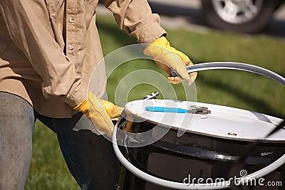 Worker Opening or Sealing Utility Drum