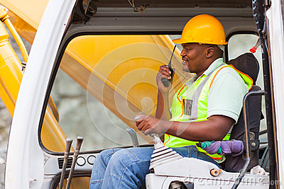 Worker operating bulldozer