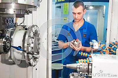 Worker operating CNC machine center