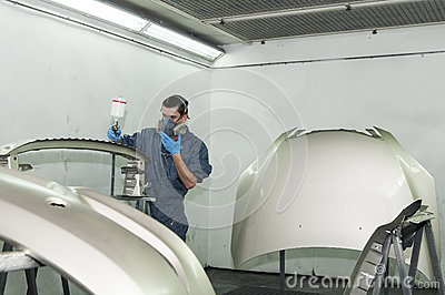worker painting a car parts stock image image 26391441. Black Bedroom Furniture Sets. Home Design Ideas