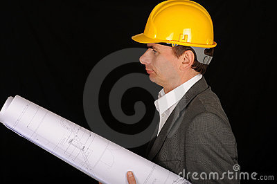 Worker with plans