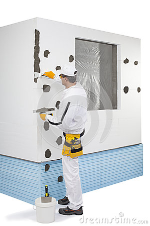 Worker preparing a corner for fixing a lath