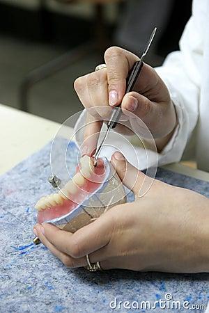 Worker producing fake teeth