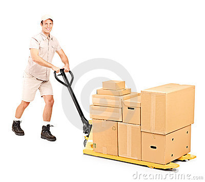 Worker pushing a fork pallet truck