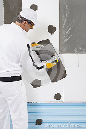 Worker reinforcing a window frame