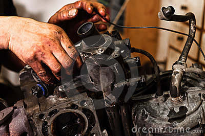 Worker repairing broken engine