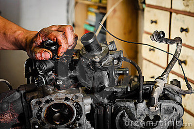 Worker repairing broken motor