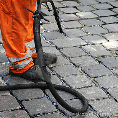 Worker repairing cobblestones