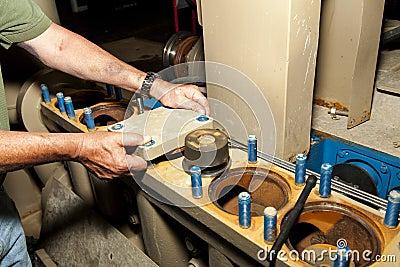 Worker Repairing Oil Field Pump