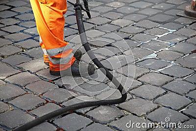 Worker repairing street