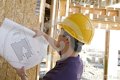 Worker Reviewing Blueprint