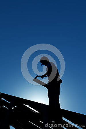 Worker on the roof structure