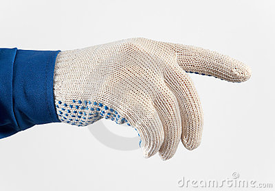 Worker s hand in gloves holding something