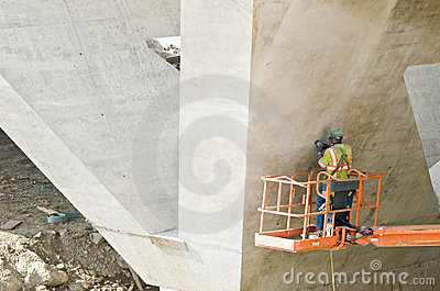 Worker Sanding Cement Seams