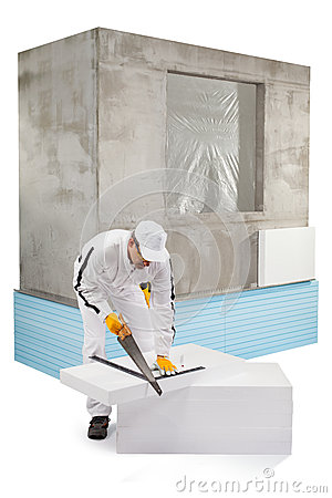 Worker sawing an insulation panel