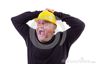Worker screaming with hands on his  head