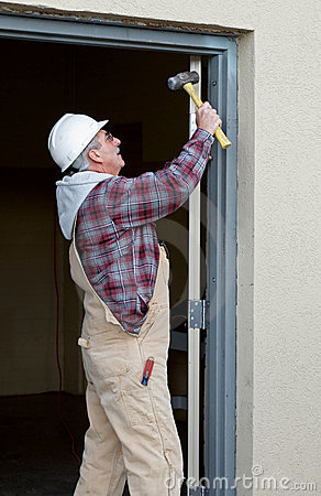 Worker Securing Door Frame