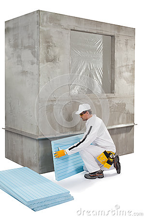 Worker setting up an insulation panel