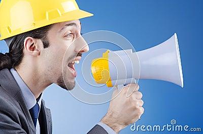 Worker shouting via loudspeaker