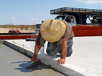 Worker Smoothing out a Concrete Slab