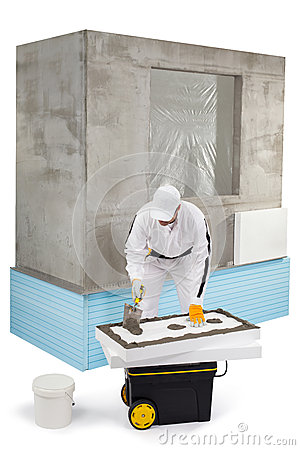 Worker spreading a putty on an insulation panel